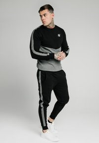 SIKSILK - CUT AND SEW JOGGERS - Pantalon de survêtement - black - 1