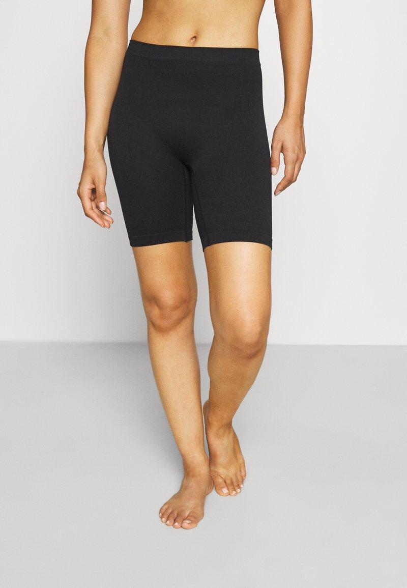 Lindex - SEAMLESS BIKER - Pants - black