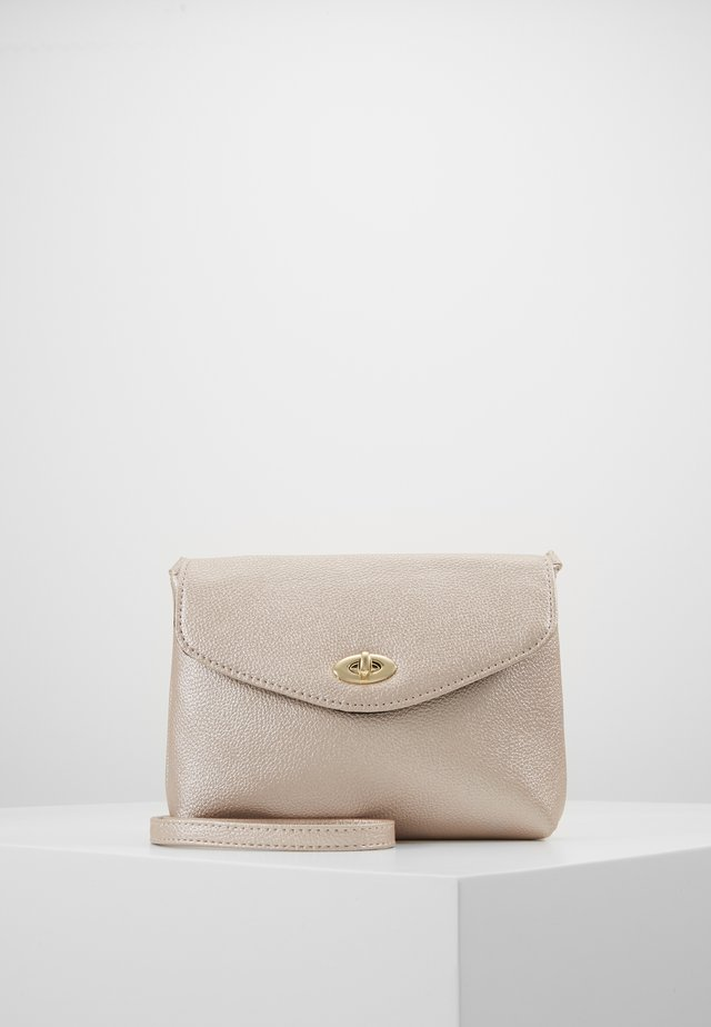 TWIST LOCK XBODY - Across body bag - rose gold-coloured