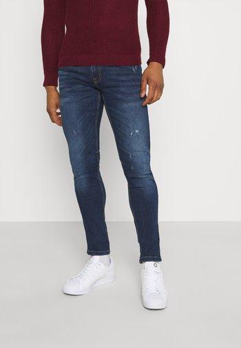 STOCKHOLM DESTROY - Jeans slim fit - caribbean sea