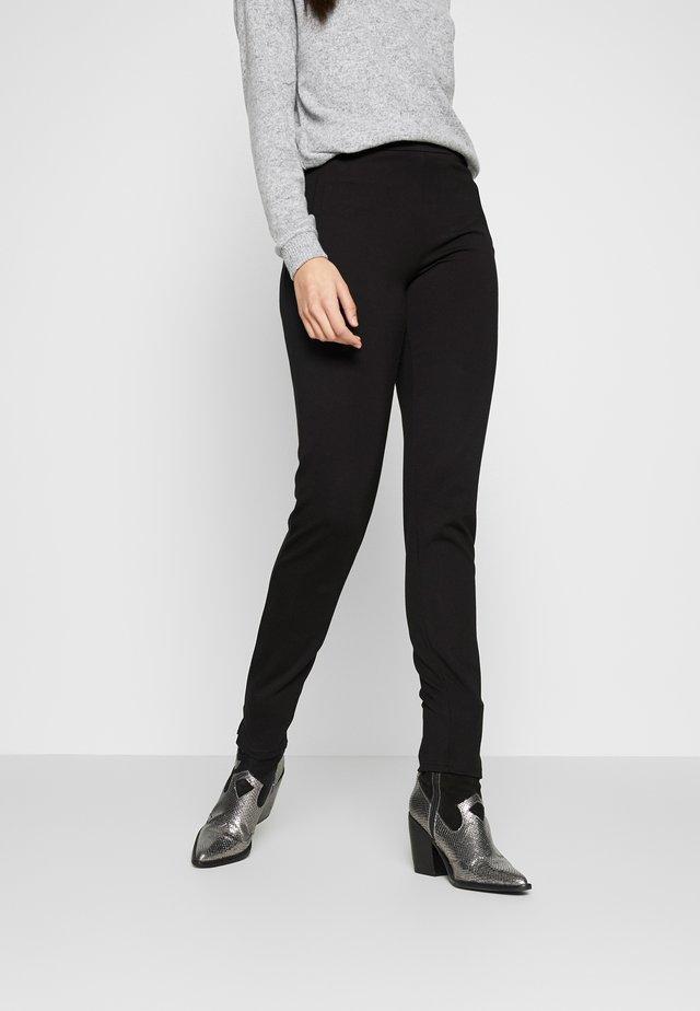 PCKLARA SLIM PANT - Kangashousut - black