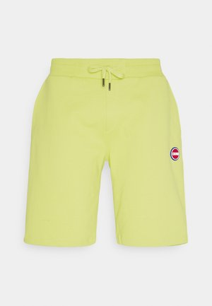 PANTS - Tracksuit bottoms - yellow