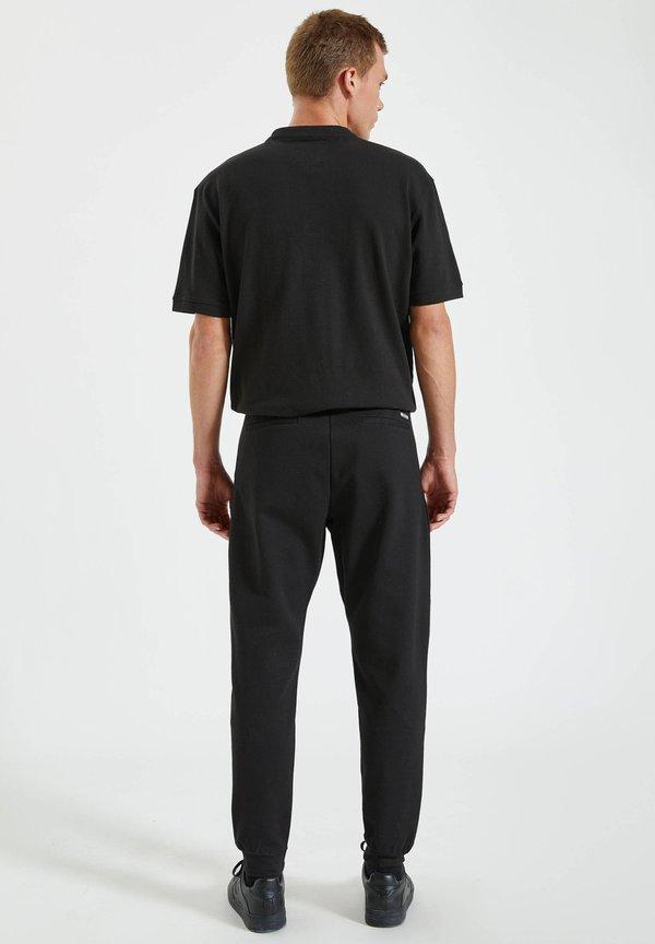 PULL&BEAR Spodnie treningowe - black/czarny Odzież Męska FOPZ