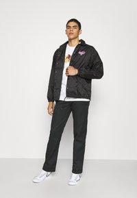 HUF - CHUN-LI & CAMMY COACH JACKET - Summer jacket - black - 1