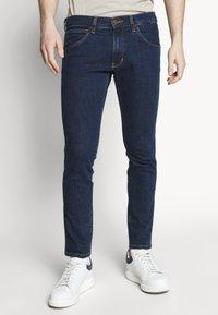 Wrangler - BRYSON - Jeans Skinny Fit - dark-blue denim - 0