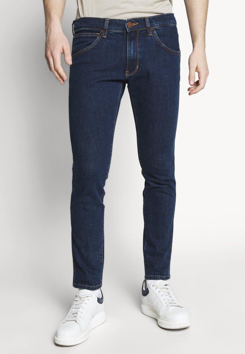 Wrangler - BRYSON - Jeans Skinny Fit - dark-blue denim