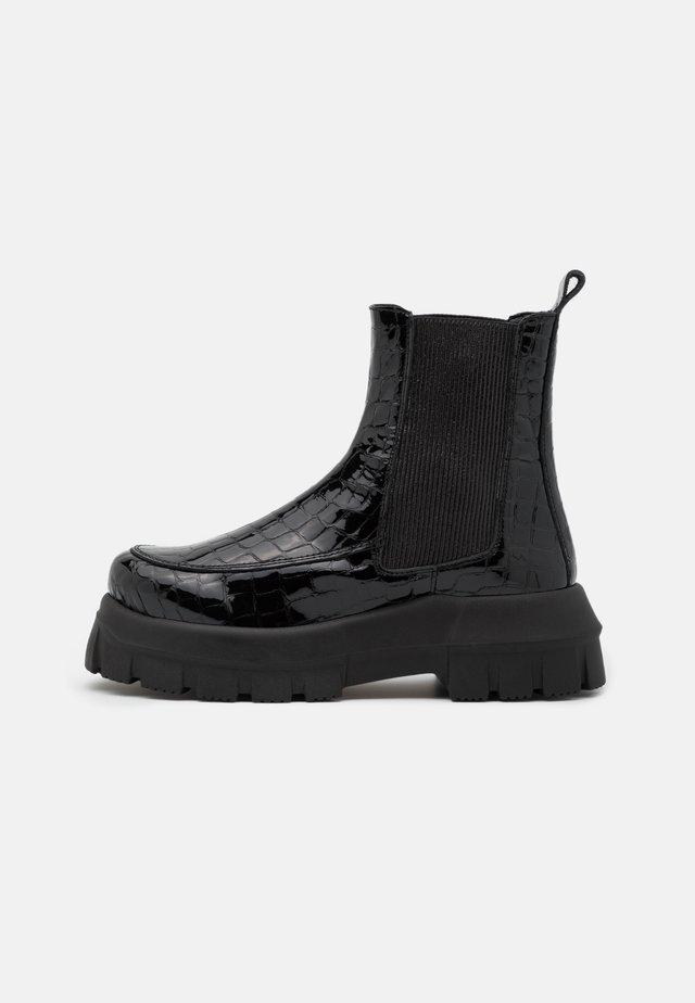 ALPHA CHUNKY - Platform ankle boots - black