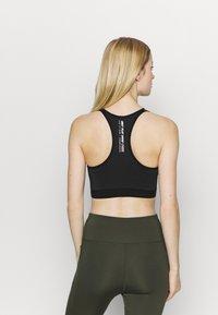 ONLY Play - ONPALANI SPORTS BRA - Medium support sports bra - black/white - 2