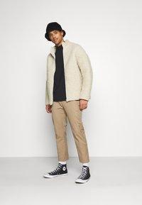 Weekday - CHEN PILE JACKET UNISEX - Winter jacket - beige - 1