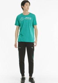 Puma - T-shirt imprimé - spectra green - 1
