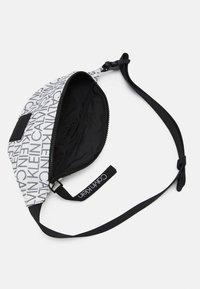 Calvin Klein - WAISTBAG MONO UNISEX - Bum bag - white - 2