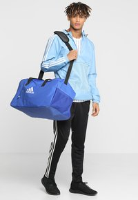 adidas Performance - TIRO DU  - Sports bag - bold blue/white - 1
