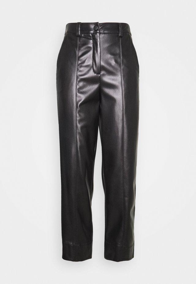 MONICA - Trousers - nero