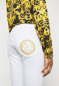 Versace Jeans Couture - Jeans Skinny Fit - optical white - 4
