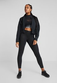Nike Performance - WARM HOLLYWOOD - Leggings - black/clear - 1