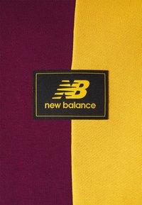 New Balance - NB ATHLETICS HIGHER LEARNING HOODIE - Sweatshirt - red/dark blue/yellow - 2