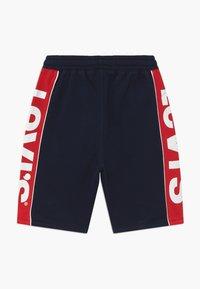 Levi's® - LOGO - Tracksuit bottoms - dark blue - 1