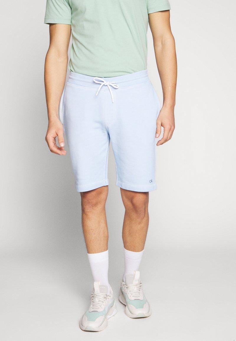 Calvin Klein - GARMENT FRONT LOGO - Verryttelyhousut - blue