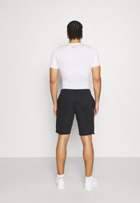 Under Armour - PROJECT ROCK TERRY SHORTS - Sports shorts - black - 2