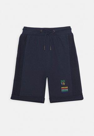 Spodnie treningowe - dunkel blau