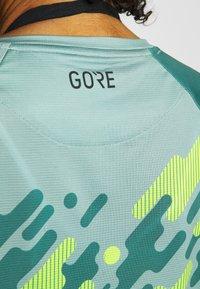Gore Wear - C5 DAMEN TRAIL TRIKOT - Funktionsshirt - nordic blue/citrus green - 4