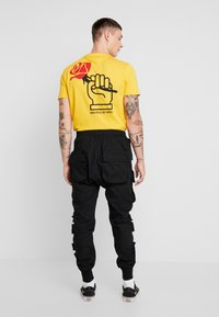 Sixth June - PANTS WITH MULTIPLE POCKETS - Cargo trousers - black - 2