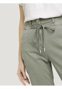TOM TAILOR - Trousers - prairie grass green - 4