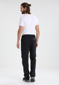 Jack Wolfskin - ACTIVATE LIGHT ZIP OFF - Outdoor trousers - black - 2