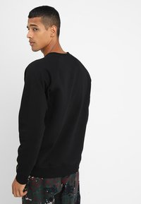 Carhartt WIP - CHASE  - Mikina - black/gold - 2