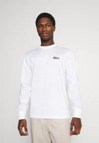 Lacoste - LACOSTE X NATIONAL GEOGRAPHIC - Long sleeved top - white - 0