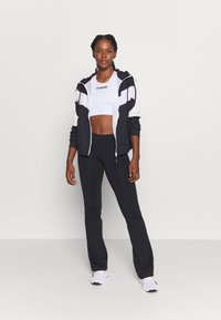 Casall - CLASSIC JAZZ PANTS - Tracksuit bottoms - black - 1