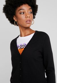 Vero Moda - VMHAPPY BASIC V NECK CARDIGAN - Cardigan - black - 4