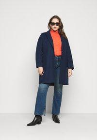 Pieces Curve - PCKAMELIA  - Flared Jeans - medium blue denim - 1