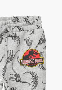 Cotton On - UNIVERSAL JURASSIC PARK LICENSE SLOUCH - Trainingsbroek - light grey - 2