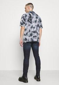 Diesel - D-AMNY-Y - Jeans slim fit - dark blue - 2