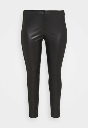OSTUNI - Leggings - Trousers - black