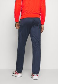 Champion - LEGACY TAPE TRACKSUIT SET - Tracksuit - red/dark blue - 4