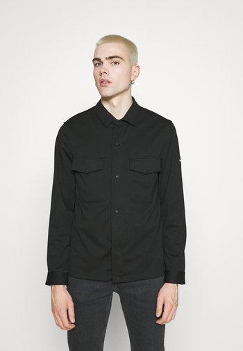 COMFORT SHIRT - Shirt - black