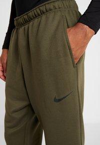 Nike Performance - DRY PANT TAPER - Tracksuit bottoms - cargo khaki/black - 4