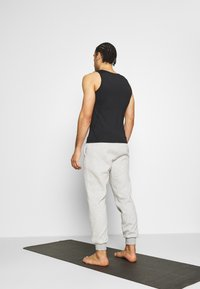 Curare Yogawear - LONG PANTS - Tracksuit bottoms - lightgrey melange - 2