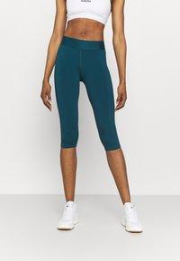 adidas Performance - CAPRI - 3/4 sports trousers - teal - 0