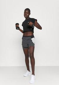 adidas Performance - RECCO CROP TEE - Triko spotiskem - black - 1