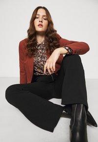 Vero Moda Curve - VMSILCO PANT - Trousers - black - 3