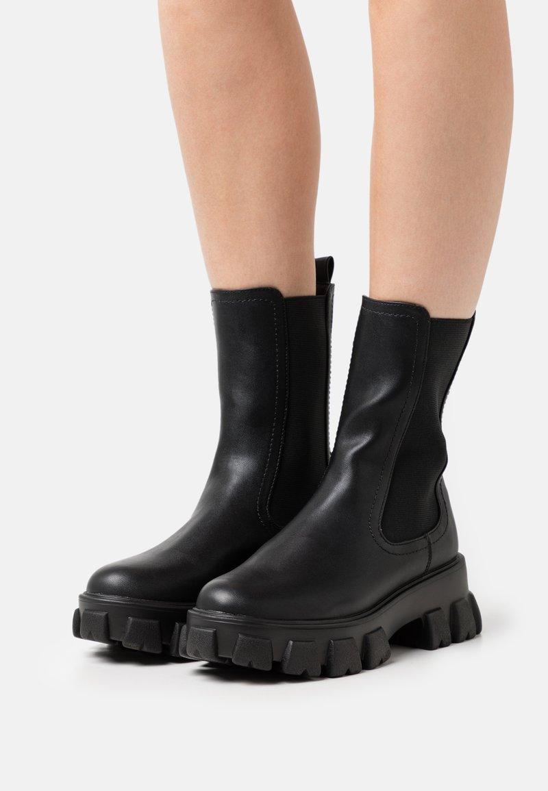 NA-KD - ELASTIC PROFILE BOOTS - Platform ankle boots - black