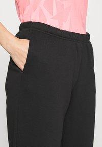 Gina Tricot Petite - BASIC - Tracksuit bottoms - black - 4