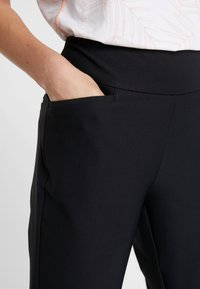 adidas Golf - PULLON ANKLE PANT - Trousers - black - 3