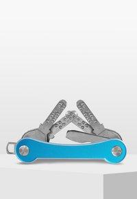Keycabins - SWISS  - Keyring - blue light-frame - 2