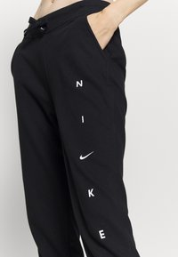 Nike Performance - DRY GET FIT PANT - Jogginghose - black/white - 4