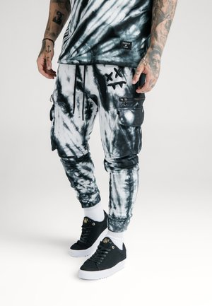 STEVE AOKI JOGGERS - Cargo trousers - black/white/ink