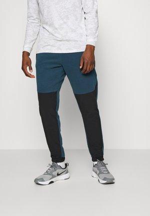 RUSH PANT - Pantaloni sportivi - blue